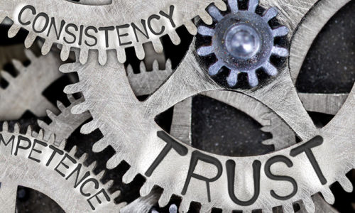 """Gears engraved with """"consistency"""", """"trust"""", and """"competence"""""""